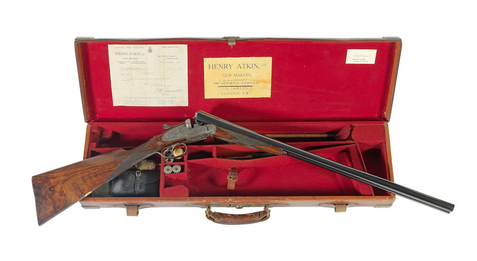 An exceptional Kell-engraved lightweight 12-bore 'Spring-Opener' sidelock ejector gun by Henry Atkin, no. 3510 In its brass-mounted leather case