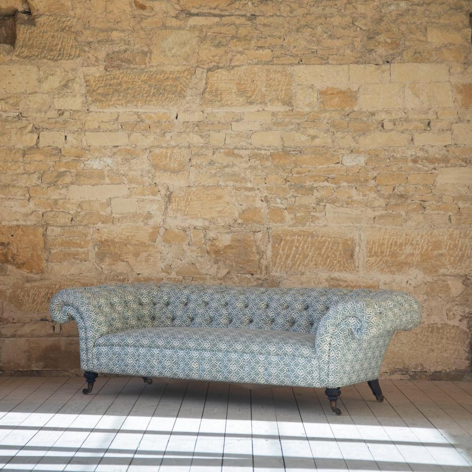 A late 19th Century Buttoned Chesterfield sofa made by Howard &Sons Circa 1880