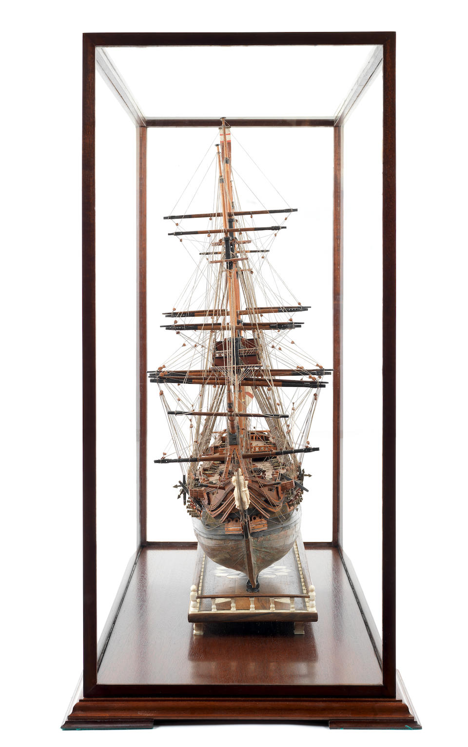 A fine Prisoner-of-War boxwood model of the first class ship of the line HMS Foudroyant,  early 19th century,  the case 76 x 89 x 39cm (30 x 35 x 15 1/2in).