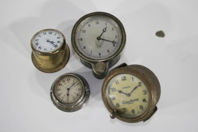 Four dashboard clocks,   ((4))
