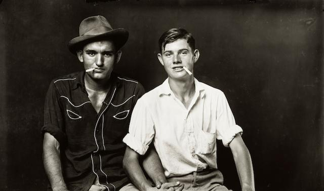 Mike Disfarmer (American, 1884-1959) Two Pals with Cigarettes  (sheet 27 x 35cm (10 3/4 x 13 3/4in)). (Executed in 1944)
