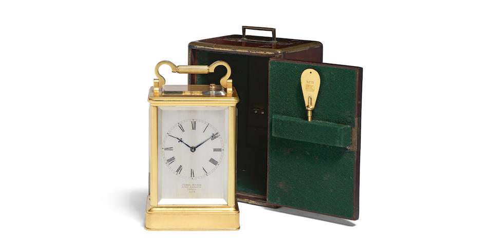 A fine and rare mid 19th century English gilt brass carriage clock in original travelling case   James McCabe, London, number 3278