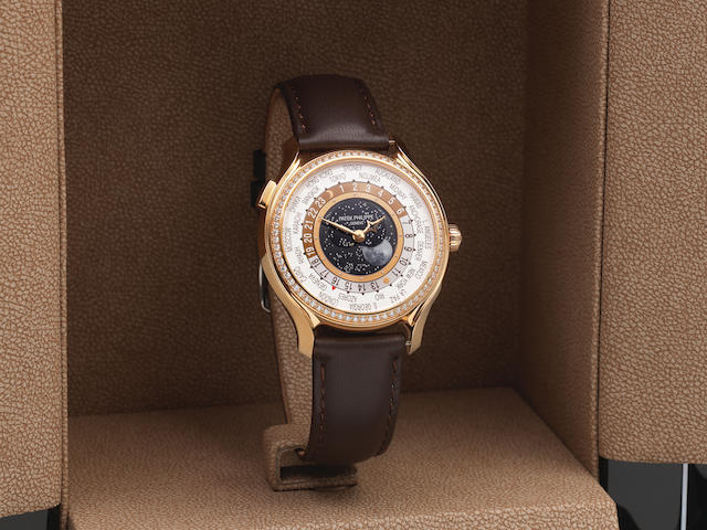 Patek Philippe. A fine and rare Limited Edition lady's 18K rose gold and diamond set World Time wristwatch with central moon phase  World Time Moonphase, Ref: 7175R-001, Purchased 10th March 2015