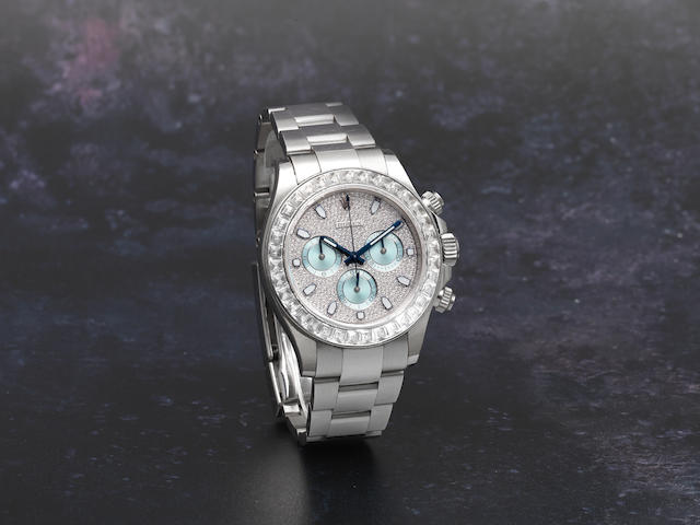 Rolex. A fine and rare platinum and baguette diamond set automatic chronograph bracelet watch  Daytona, Ref: 116576TBR, Purchased 22nd October 2014