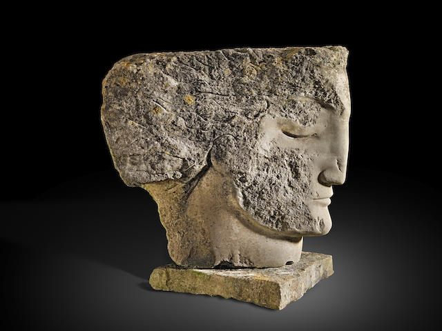 Emily Young (British, born 1951) Poet Warrior 80 cm. (31 1/2 in.) high (including the stone base) (Carved in 2000)