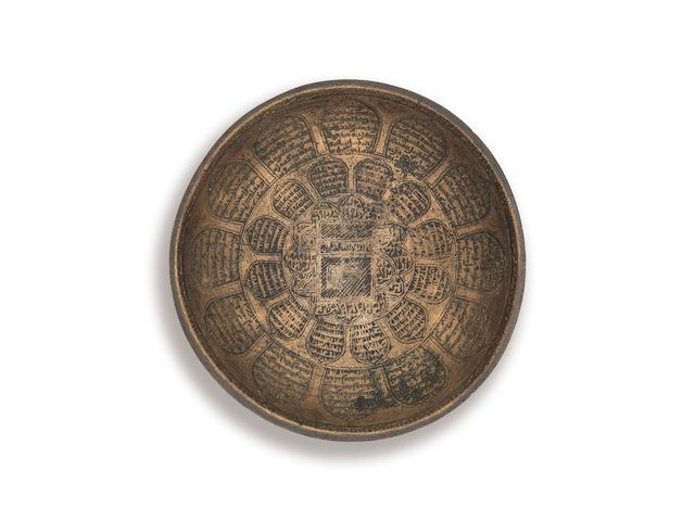 A rare Ayyubid bronze magic bowl depicting the ka'ba Egpyt or Syria, 13th/ 14th Century